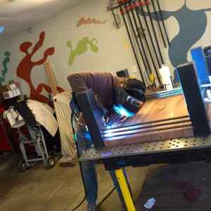 Phil doing his magic, welding the tabs to hold up the top